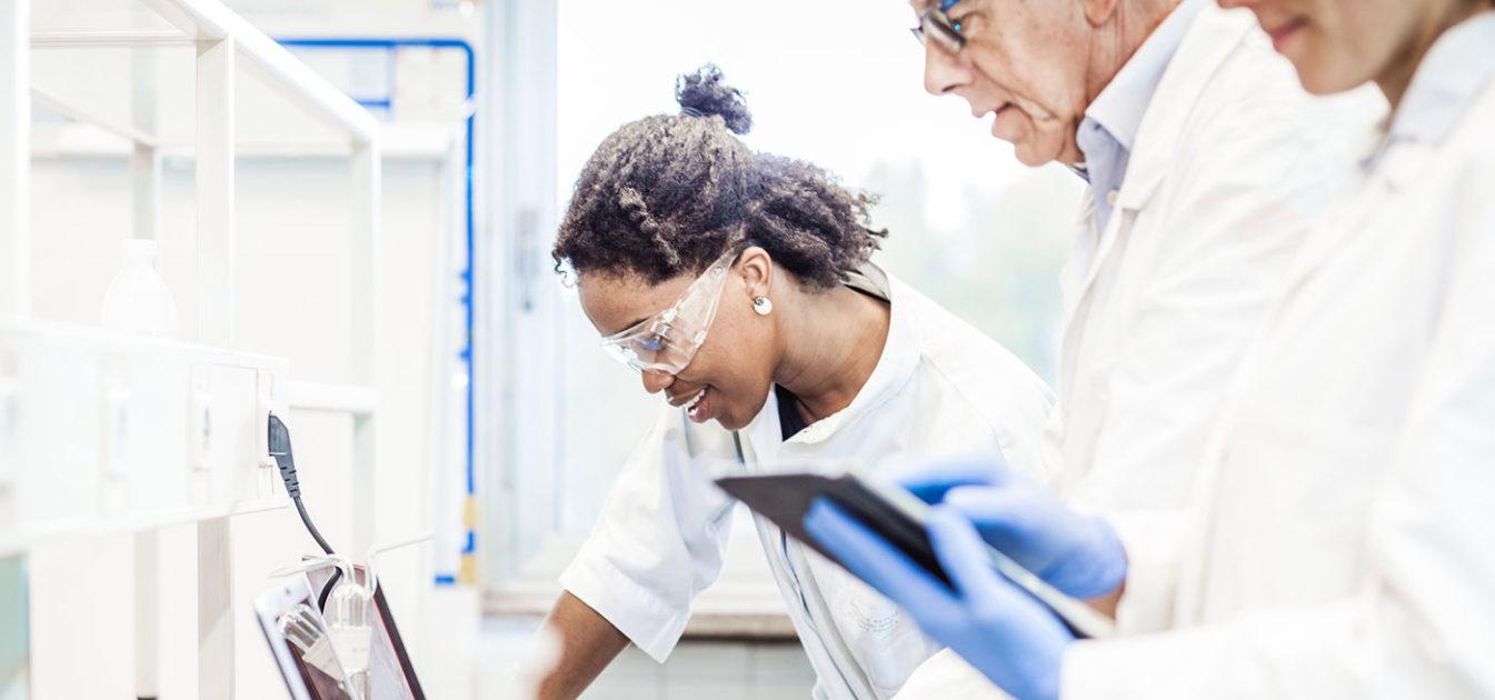 three lab researchers collaborate